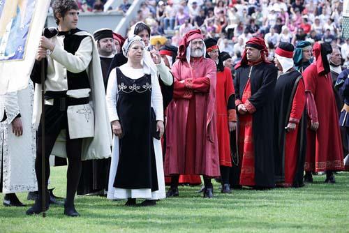 participants in mediaeval costume on field at the Corsa all'anello in Narni Umbria